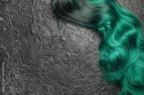 Unusual wig on dark background