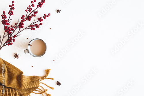Autumn composition. Plaid, cup of coffee on white background. Autumn, winter concept. Flat lay, top view