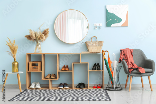 Stylish interior of modern hall with shoes on stand Canvas