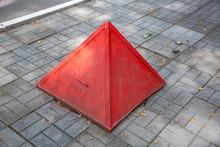 Rusty Iron Pyramid Shaped Road Sign Warns Of Danger