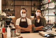 Coffee Shop Owners With Face M...