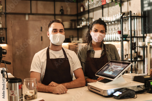 Fototapety, obrazy: Coffee shop owners with face masks, lockdown, quarantine, coronavirus, back to normal concept