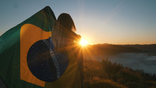 Brazilian Girl With National Flag At Sunrise