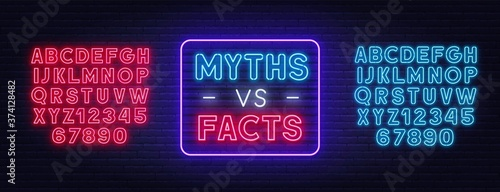 Fotomural Myths vs facts neon sign on brick wall background