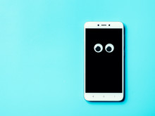 Googly Eyes On Smartphone Scre...