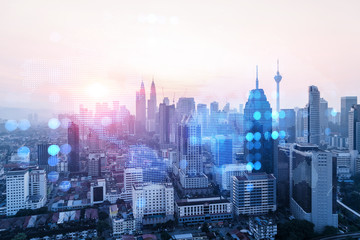 Glowing hologram of Earth planet map on aerial panoramic cityscape of Kuala Lumpur at sunset, Malaysia, Asia. The concept of international business in KL. Multi Exposure.
