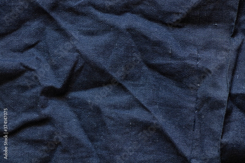 Tablou Canvas blue wrinkled dark fabric as background close-up close up