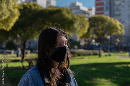 Papel de parede Young woman with chinstrap covid 19 quarantine concept