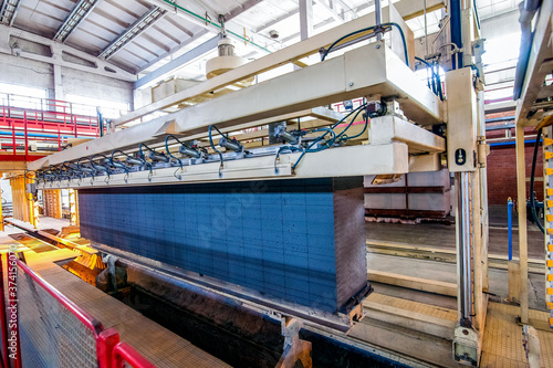 Photo Production of aerated concrete blocks at factory processing step