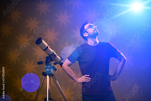 Amateur astronomer looking at the stars with a telescope Canvas Print