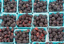Wild Red And Black Blackberries At Farmers Market
