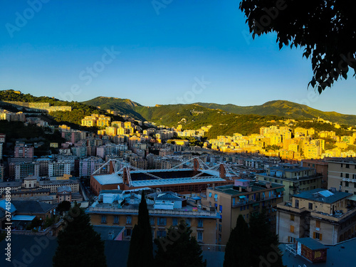 Genova, Italy - 08/25/2020: Beautiful aerial photography of the Luigi ferraris Stadium and the port of genova in summer days with the city skylines and the sea in the background Wallpaper Mural