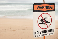 No Swimming Danger Sign On The...