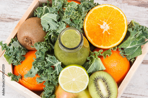 Fototapeta Freshly blended coctail from fruits with vegetables as healthy dessert containin