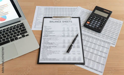 Fotografie, Tablou accaccounting report with financial statement on accountant desk