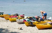 Many Colorful Sea Tandem Kayak On Beach