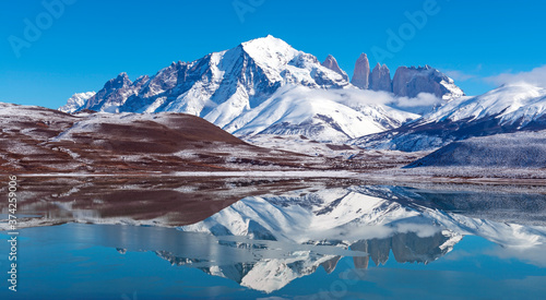 Fényképezés Panoramic reflection of the Torres del Paine granite peaks in winter with copy space, Torres del Paine national park, Patagonia, Chile