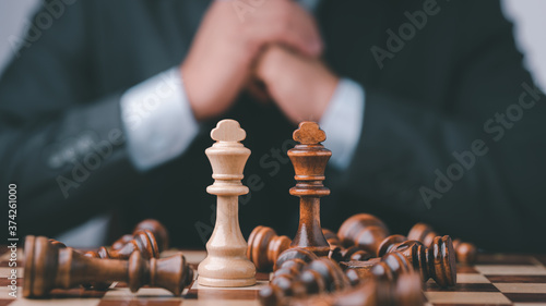 Fototapeta Businessman Analyze chess piece on chess board game concept for ideas and competition and strategy, business success concept, business competition planing teamwork strategic concept
