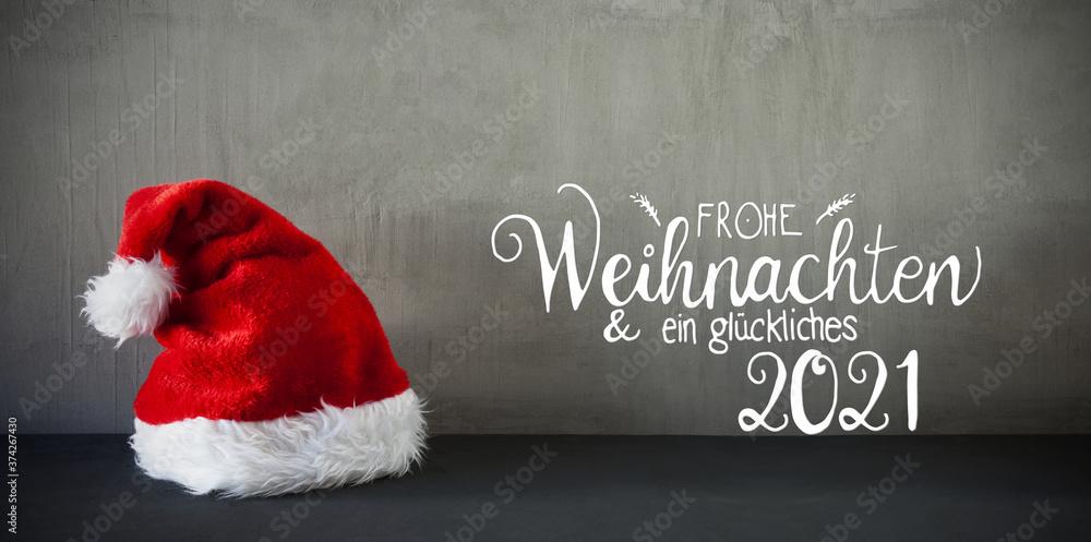 Fototapeta Red Santa Hat, Cement, Calligraphy Glueckliches 2021 Means Happy 2021