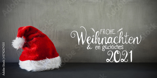 Photographie Red Santa Hat, Cement, Calligraphy Glueckliches 2021 Means Happy 2021