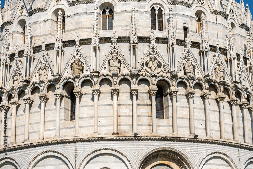Closeup of the Pisa Baptistery (Battistero di San Giovanni) in Romanesque Gothic style, Piazza or Campo dei Miracoli (Square of Miracles). Tuscany, Italy, Europe