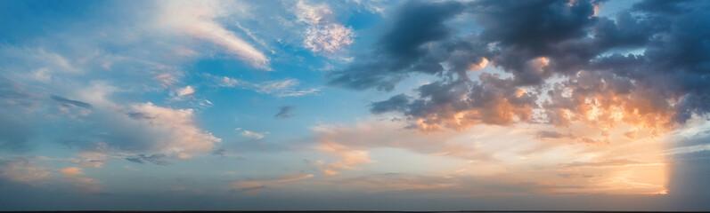 Panorama, cloudy sky at sunset. Pink clouds.
