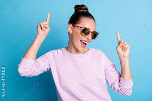 Fototapeta Close-up portrait of her she nice attractive pretty lovely charming cheerful cheery girl dancing having fun weekend chill out isolated over bright vivid shine vibrant blue color background