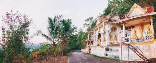 A bit abandoned buddhist temple near a road. Phuket, Thailand. Fotobehang