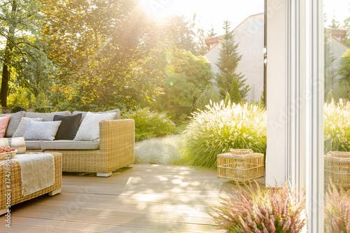 Fotografie, Obraz Beautiful summer day in elegant home garden with trendy furniture
