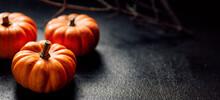 Pumpkins On A Dark Background,...