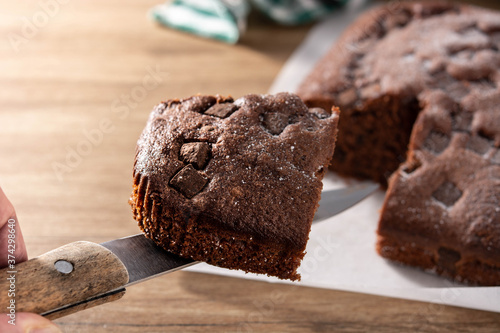 Sweet chocolate sponge cake on wooden table. Canvas Print