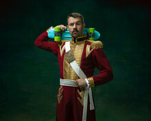 Skater Man. Young Man In Suit As Nicholas II Isolated On Dark Green Background. Retro Style, Comparison Of Eras Concept. Beautiful Male Model Like Historical Character, Monarch, Old-fashioned.