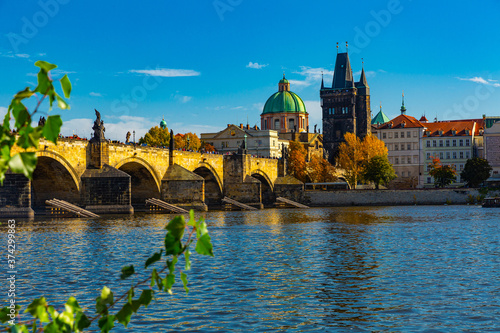 Scenic view of autumn Prague cityscape and ancient stone Charles Bridge across V Canvas Print