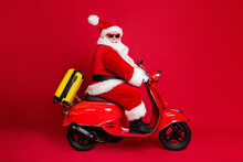 Next Stop Tropic Island. Full Length Profile Photo Of Retired Grandpa White Beard Ride Vintage Moto Vehicle Speed Bag Wear Santa X-mas Costume Coat Sunglass Cap Isolated Red Color Background