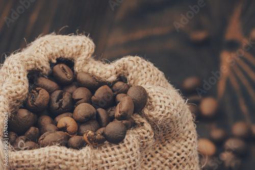 Tela burlap sack of roasted  coffee beans. Close up