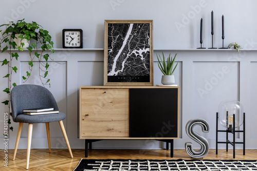 Modern scandinavian home interior with mock up poster frame, design wooden commode, big cement letter, cacti, plants, decoration, shelf and personal accessories in stylish home decor.