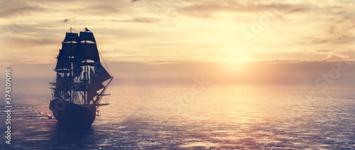 Pirate ship sailing on the ocean at sunset Fototapete