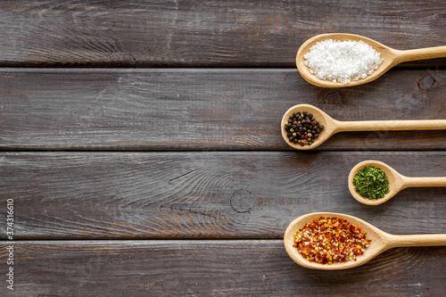Slika na platnu Herbs spices and flavoring on kithen desk, top view