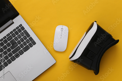 Fotografie, Tablou Laptop with VR glasses on yellow background