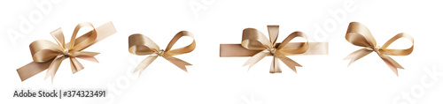 Obraz A collection of gold ribbon bows for Christmas, birthday and valantines presents isolated against a white background - fototapety do salonu