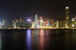 City landscape. Victoria Harbor and Hong Kong skyscrapers at night.