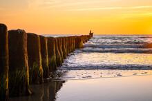 Wooden Poles At The Beach At G...
