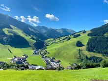 View Of Hinterglemm Village And Mountains With Skiing Lifts In Saalbach-Hinterglemm Skiing Region In Austria On A Beautiful Summer Day.