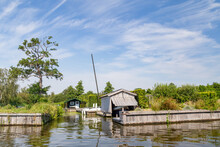 Wooden Boathouse And Summerhouse Along Paterswoldsemeer A Lake Near Groningen In The Netherlands On A Summer Day