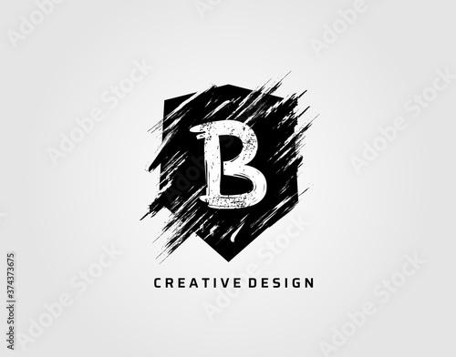 Obraz na plátně Grunge Shield Icon With Letter B. Rustic Shield Logo.