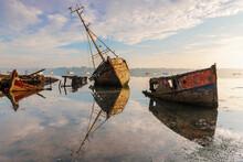 Derelict Wooden Boats Reflecte...