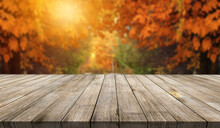 Wooden Desk On Autumn Blur Abs...