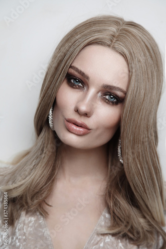Portrait of young beautiful girl with long hair and fancy smoky eye makeup Canvas