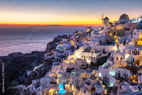 Fotografiet Sunset at the Island Of Santorini Greece, beautiful whitewashed village Oia with