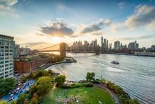 View Of Brooklyn Bridge And Manhattan Skyline At Sunset, New York City, USA